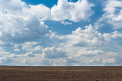 Arable land and sky. Arable land and cloudy sky Stock Images