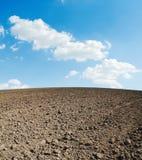 Arable soil and blue sky Stock Photos