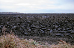 Arable, tillage. A ploughed field. Agriculture. The smell of the earth Royalty Free Stock Photo