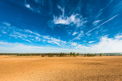 Arable. Tractor plowed field in the spring morning Stock Images