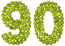 Arabski liczebnik 90, dziewiećdziesiąt, od zielonych grochów, odizolowywających na białych półdupkach zdjęcia royalty free