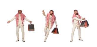 Arabski m??czyzna z torba na zakupy na bielu obraz royalty free