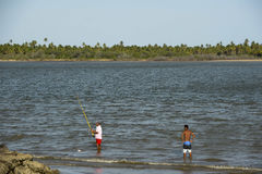 Aracaju-SE. Aracaju, Brazil - november 19, 2016:  Fishermen on the banks of the Sergipe river, in Aracaju Royalty Free Stock Photo
