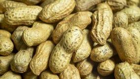 Arachidi, arrostite con sale nella macro vista Fotografia Stock