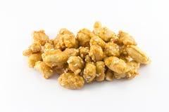 Arachidi in caramello con i semi di sesamo Fotografia Stock Libera da Diritti
