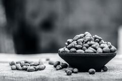 Arachis hypogaea, Raw fresh peanuts in a clay bowl on gunny background. Arachis hypogaea, Raw fresh peanuts in a clay bowl on gunny  background Stock Photography