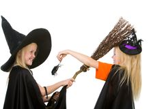Arachnid scare. Portrait of girl in warlock scaring her sister by creepy spider Stock Images