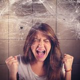 Arachnophobia. Girl screaming trapped in a spider web Stock Photos