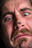 Arachnophobia Man Scared. Close up scared man with spider on his nose, arachnophobia concept Royalty Free Stock Image
