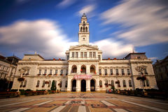 Arad City Hall. Arad city center with city hall and long exposure that blurr the clouds Royalty Free Stock Photography