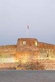 Arad fort lighting in the evening. Arad Fort is a 15th century fort in Arad, Bahrain Stock Photography