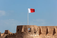 Arad fort with the national flag of Bahrain. Historic Arad fort with national flag of Bahrain, Middle East Stock Image