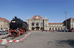 Arad railway station. View of Arad railway station with steam locomotive in front Stock Photo