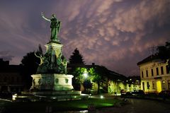 ARAD, ROMANIA, 28 JUNE, 2019: The Reconciliation Park of Arad under stormy clouds. Stormy clouds over the Statue of Liberty and buildings of the Reconciliation stock photos