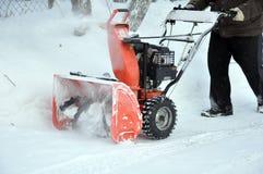 Arado de nieve en trabajo Fotos de archivo