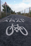 Araf. /slow painted sign on a cycle track in Cardiff Bay Stock Image