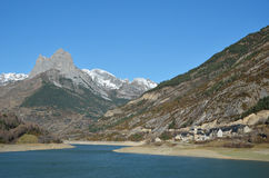 Aragon Pyrenees. The recognizable mountain (Pena Foratata) is towering above the artificial lake (Embalse de Lanuza) in the Aragon Pyrenees Royalty Free Stock Photos