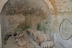 The Aragonese castle cellar with old barrels and bottles. Covered with dust and antiquity Royalty Free Stock Images