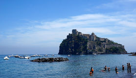 Aragonese castle. Near Ischia island with people bathing in the sea Stock Photo