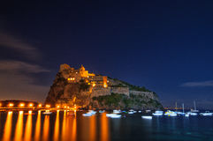 Aragonese castle at night. Bay of Naples, Ischia island, Italy. Aragonese castle at night. Mediterranean Sea coast, bay of Naples, Ischia island, Italy Stock Images