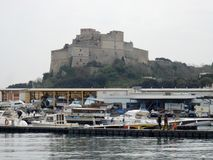 Aragonese Castle from the port of Baia. Pozzuoli, Naples, Campania, Italy - April 11, 2018: Aragonese seen from the port of Baia Stock Images