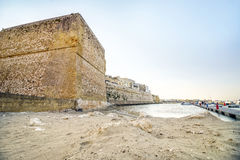 Aragonese castle and sandy beach in Otranto, Apulia, Italy Stock Images