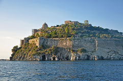 The Aragonese castle in the setting sun. The famous Aragonese castle near the Italian island of Ischia in the rays of the setting sun Royalty Free Stock Photography