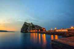 Aragonese castle at sunrise. Bay of Naples, Ischia island, Italy. Aragonese castle at sunrise. Mediterranean Sea coast, bay of Naples, Ischia island, Italy Stock Photos