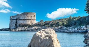 Aragonese tower by the coast. In Alghero, Sardinia Royalty Free Stock Photos
