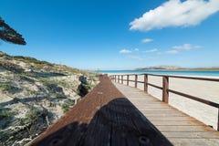 Aragonese tower in La Pelosa. Aragonese tower seen from the boardwalk in La Pelosa beach Stock Images