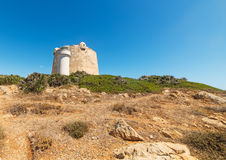 Aragonese tower and lighthouse. Lighthouse and Aragonese tower in Porto Conte, Sardinia Stock Photo