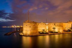 Aragonian Castle On The Sea Of The Taranto Canal Boat Illuminate. D By Christmas Lights At Night During The Christmas Period Stock Photography