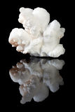 Aragonite white crystals. Beautiful round Aragonite clusters, a carbonate mineral, a crystal form of calcium carbonate Royalty Free Stock Photography