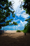 ARAGUSUKU Beach from the Shade of the Trees, Okinawa Prefecture/ Royalty Free Stock Photography