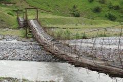 Aragwi Valley, Georgian Military Road, Georgia. Swing bridge across the Aragwi River, Georgian Military Road, Georgia, Europe Stock Image