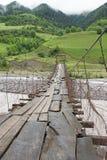 Aragwi Valley, Georgian Military Road, Georgia. Swing bridge across the Aragwi River, Georgian Military Road, Georgia, Europe Royalty Free Stock Photo