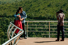 Araku Valley Scenic View. A tourist couple is photographed the memory of their touring happiness by a hired photographer at Araku Valley view point, India. Araku Stock Image