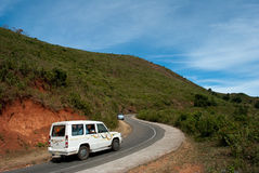 Araku Valley Scenic View. A tourist jeep on the road of Araku valley is one of the tourism destinations in the state of Andhra Pradesh, India. Araku Valley, is Royalty Free Stock Photos