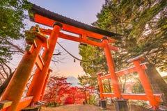 Arakura Sengen Shrine Gate. Fujiyoshida, Japan with the entrance gate to Arakura Sengen Shrine and Mt. Fuji in the distance during autumn season Stock Photo