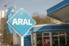 Aral. Big Aral sign next to a petrol station with copy space to the right Royalty Free Stock Photo
