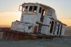 Abandoned ships Aral Sea. The Aral Sea is a formerly un salt lake in Central Asia. The Aral Sea was an endorheic lake lying between Kazakhstan in the north and Stock Photo