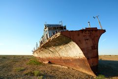 Abandoned ships Aral Sea. The Aral Sea is a formerly un salt lake in Central Asia. The Aral Sea was an endorheic lake lying between Kazakhstan in the north and Stock Photography