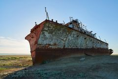 Abandoned ships Aral Sea. The Aral Sea is a formerly un salt lake in Central Asia. The Aral Sea was an endorheic lake lying between Kazakhstan in the north and Stock Image