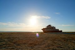 Abandoned ships Aral Sea. The Aral Sea is a formerly un salt lake in Central Asia. The Aral Sea was an endorheic lake lying between Kazakhstan in the north and Stock Images