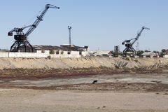 Aral Sea - kazakhstan. Old abandoned cranes in Aral harbour Royalty Free Stock Photo