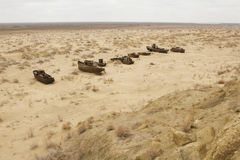 Aral sea shipwreck. The ship`s skeleton is on the sand Royalty Free Stock Image