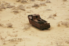 Aral sea shipwreck. The ship`s skeleton is on the sand Stock Photo