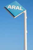 Aral sign against blue sky Royalty Free Stock Images