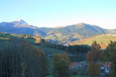 Aramaio, Basque Country. Altzaga auzoa with Mount Anboto in the background, in autumn; Aramaio, Araba, Basque Country Royalty Free Stock Images