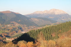 Aramaio, Basque Country. View of Aramaio with Mount Udalaitz in the background, from Krutzeta, in autumn; Araba, Basque Country Royalty Free Stock Photo